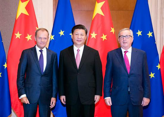 President Xi Jinping meets with European Council President Donald Tusk (left) and European Commission President Jean-Claude Juncker at the Diaoyutai State Guesthouse in Beijing on Monday. Xi said the two sides should step up strategic dialogue and coordination. (LI XUEREN / XINHUA)