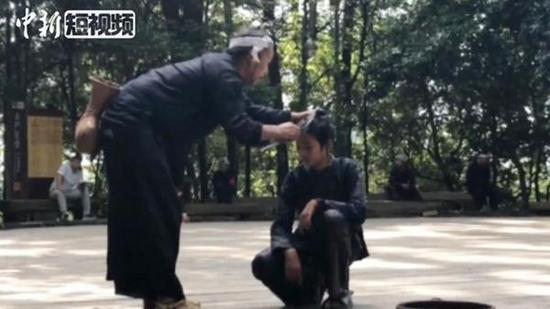 China's last gun tribe carries out ceremonial haircut with a sickle