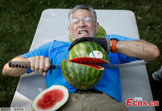 Man challenges Guinness record for slicing watermelons on stomach