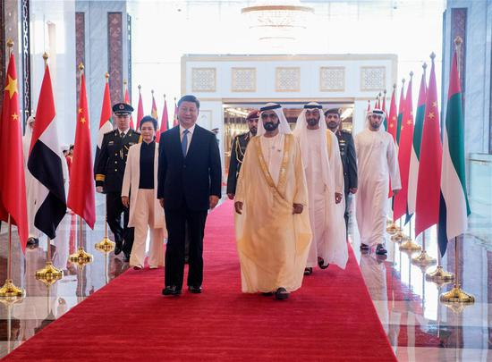 Chinese President Xi Jinping and his wife Peng Liyuan, accompanied by the United Arab Emirates (UAE) Vice President and Prime Minister Sheikh Mohammed bin Rashid Al Maktoum and the Crown Prince of Abu Dhabi Sheikh Mohammed bin Zayed Al Nahyan, head for a reviewing hall in Abu Dhabi, the UAE, July 19, 2018. Xi arrived here on Thursday for a state visit to the UAE. The UAE's vice president hosted a welcome ceremony for the Chinese president at the airport. (Xinhua/Li Xueren)
