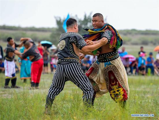 People take part in Nadam Fair in north China's Inner Mongolia
