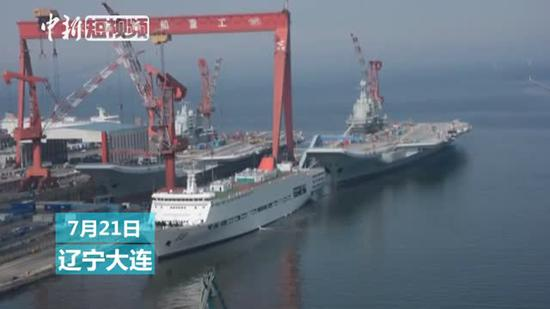 China's two aircraft carriers docked side by side