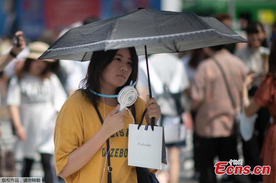 Japanese heat wave pushes temperature to record
