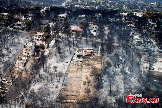 Greece fires: Photos show scale of damage