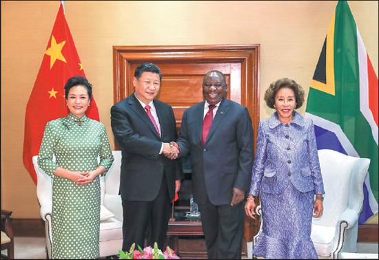 President Xi Jinping meets with his South African counterpart, Cyril Ramaphosa, in Pretoria, South Africa, on Tuesday. They are accompanied by Xi's wife, Peng Liyuan, and Ramaphosa's wife, Tshepo Motsepe. (Photo: Xie Huanchi / Xinhua)