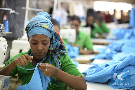 File photo shows a worker at Bole Lemi Industrial Park in Addis Ababa, capital of Ethiopia, April 6, 2017.(Xinhua/Michael Tewelde)