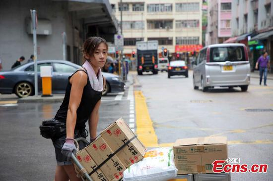 Female porter says she enjoys her job in Hong Kong