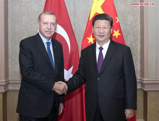 Chinese President Xi Jinping (R) meets with his Turkish counterpart Recep Tayyip Erdogan in Johannesburg, South Africa, July 26, 2018. (Xinhua/Wang Ye)
