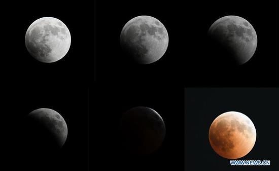 People watch longest total lunar eclipse of century around world