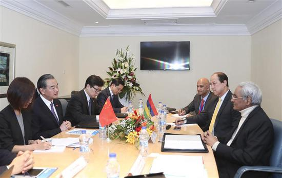 Chinese State Councilor and Foreign Minister Wang Yi meets with Mauritian Foreign Minister Vishnu Lutchmeenaraidoo in Port Louis, Mauritius, July 28, 2018. Wang Yi accompanied Chinese President Xi Jinping in his friendly visit to Mauritius. (Xinhua/Ding Lin)