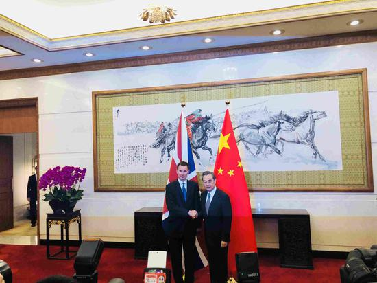 Chinese State Councilor and Foreign Minister Wang Yi meets with his British counterpart Jeremy Hunt in Beijing, July 30, 2018. (Photo/CGTN )