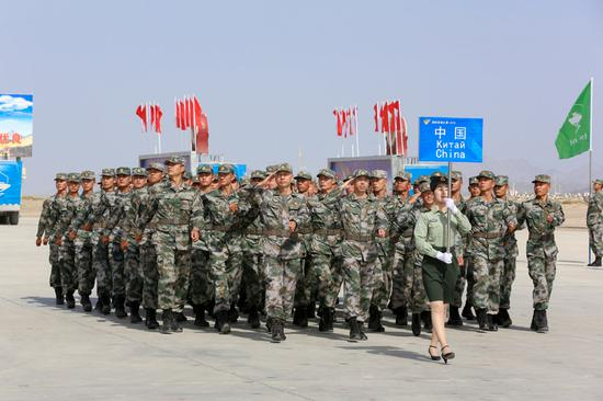 Chinese soldiers take part in an opening ceremony of the International Army Games 2018 in Korla, Xinjiang Uygur autonomous region on July 29, 2018. (Photo/Xinhua)