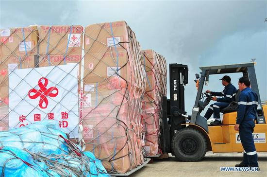 The emergency relief from Chinese government to Laos is unloaded from a Chinese cargo plane at the Wattay International Airport, in Lao capital Vientiane, on July 30, 2018. The humanitarian emergency relief of the Chinese government's assistance for the flooded southern Laos was handed over to the Lao side on Monday in Lao capital Vientiane. The aid includes 100 boats, 500 tents and 100 water clarifiers. (Xinhua/Zhang Jianhua)