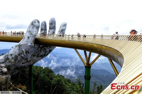 Giant hands cradle Vietnam's new Golden Bridge