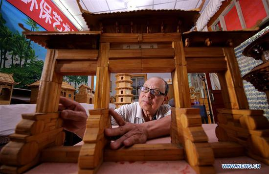 70-year-old makes handicrafts using discarded wooden sticks