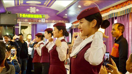 Cabin crew on one of the tourism trains along Tangzhu Road. (Photo provided to China Daily)