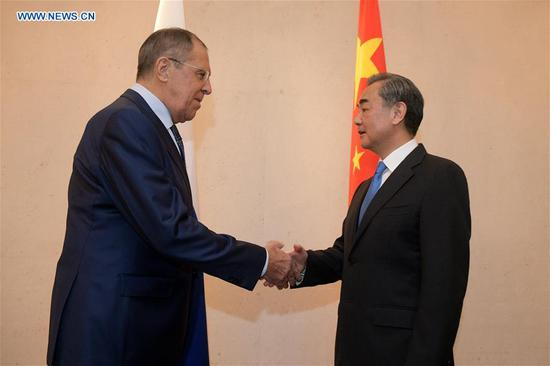 Chinese State Councilor and Foreign Minister Wang Yi (R) meets with Russian Foreign Minister Sergei Lavrov on the sidelines of the ASEAN foreign ministers' meeting and related meetings, in Singapore, Aug. 2, 2018. (Xinhua/Then Chih Wey)