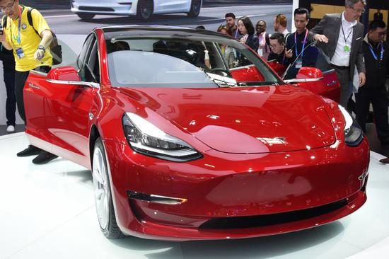 A Tesla Model 3 sedan is displayed during an auto expo in Beijing. (Photo provided to China Daily)