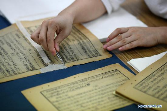 老师在13年的职业生涯中恢复了1000多本古籍