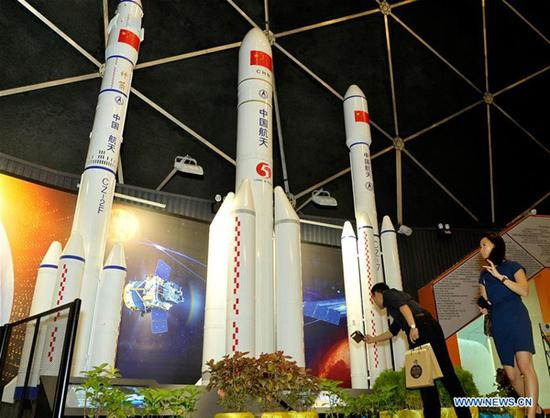 People look at Chinese rockets models at the Space Exploration Gallery in Penang, Malaysia, Aug. 4, 2018. Malaysian people in the northern state of Penang were able to have a close look at the models of the rockets and spacecraft used in China's space missions such as the Yutu moon rover with the opening of the Space Exploration Gallery on Saturday. (Xinhua)