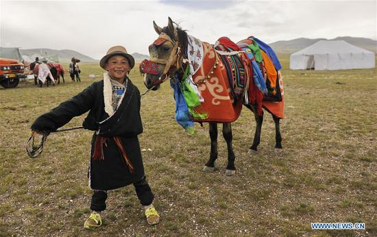 Herdsmen ride and race horses to celebrate cashmere harvest in Tibet