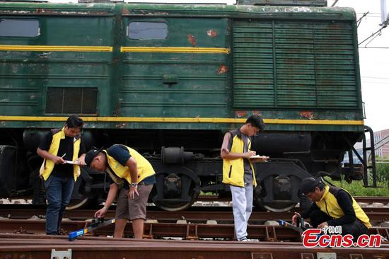 Thai students study high-speed rail in Guangxi