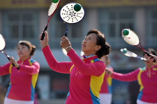 Retirees and homemakers practise taichi at a playground in Chaohu, Anhui Province. (Photo by Li Yuanbo/For China Daily)