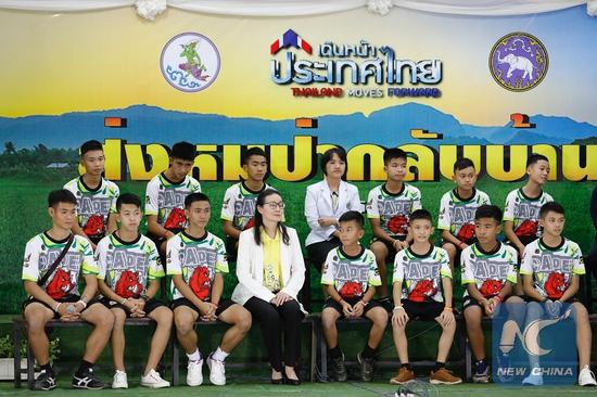 The 12 boys and their football coach rescued from a flooded cave in northern Thailand made their first public appearance here at a press conference on July 18. (Xinhua/Rachen)