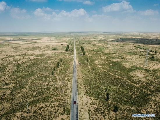 New road through Kubuqi Desert under construction in Inner Mongolia