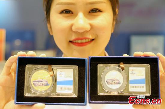 New souvenirs mark 10thanniversary of Beijing Olympics