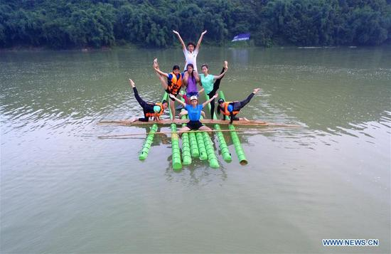 Students practice single bamboo drifting in Guizhou