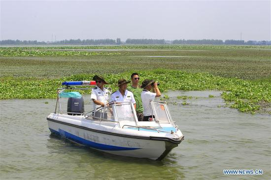 Patrollers at Xiaogang lake-patroller station in Honghu, Hubei