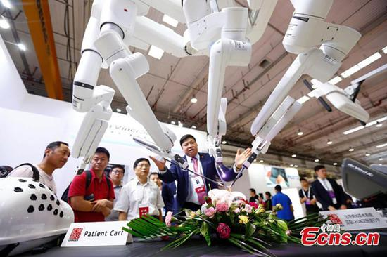 Robot products on display at the World Robot Conference 2018 in Beijing, Aug. 15, 2018. The conference included a competitive section, which attracted contestants from 16 countries and regions. (Photo: China News Service/Fu Tian)