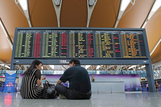 Flights suspended in Shanghai due to Typhoon Rumbia