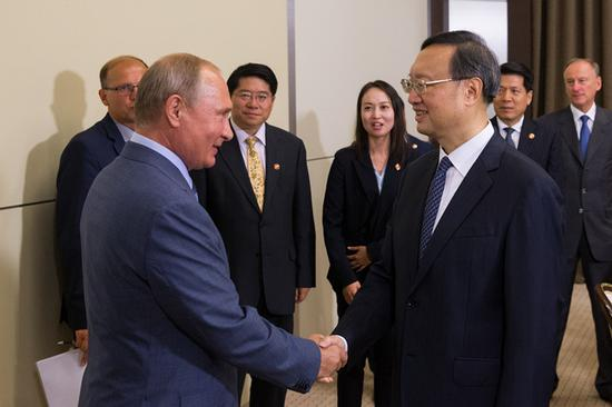 Russian President Vladimir Putin meets with Yang Jiechi, a member of the Political Bureau of the Communist Party of China Central Committee and director of the Office of the Foreign Affairs Commission of the CPC Central Committee, in Sochi, Russia on Wednesday. (YANG XUEQI/XINHUA)