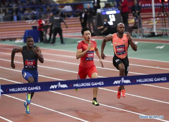 Xie Zhenye(C) of China competes during the Joe Yancey Men's 60m of the 111th NYRR Millrose Games in New York, the United States on Feb. 3, 2018. Xie Zhenye won the third place by 6.588 seconds. (Xinhua/Wang Ying)