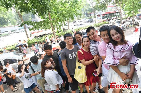 New couples wait in long line to register for marriage