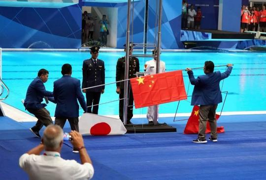 Flags rise again for swimming medalists after Sun's demand