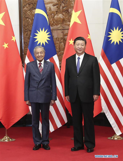 Chinese President Xi Jinping (R) meets with Malaysian Prime Minister Mahathir Mohamad in Beijing, capital of China, Aug. 20, 2018. (Xinhua/Pang Xinglei)