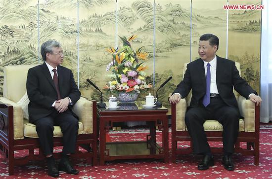 Chinese President Xi Jinping (R), also general secretary of the Central Committee of the Communist Party of China, meets with Tran Quoc Vuong, a member of the Politburo of the Communist Party of Vietnam (CPV) Central Committee and permanent member of the CPV Central Committee's Secretariat, in Beijing, capital of China, Aug. 20, 2018. (Xinhua/Xie Huanchi)