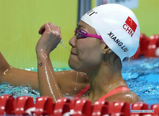 Liu breaks nine-year world record to win 50m backstroke