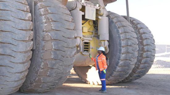 Female Namibian truck driver in Chinese-run uranium mine
