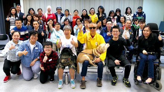 Pompe patient Terry Lai (first row, second right) works in the Hong Kong Alliance of Rare Diseases' campaigns to seek welfare rights for rare-disease patients in the city. (Photo/China Daily)