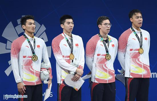 Xu Jiayu, Yan Zibei, Li Zhuhao and Yu Hexin (from L to R) attend the awarding ceremony of men's 4x100m medley relay final of swimming at the 18th Asian Games in Jakarta, Indonesia, Aug. 24, 2018. China won the gold medal. (Xinhua/Yue Yuewei)