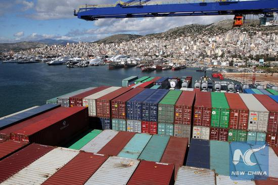 Containers on China's COSCO Shipping Taurus are seen at Piraeus port, Greece, on Feb. 26, 2018. (Xinhua/Marios Lolos)