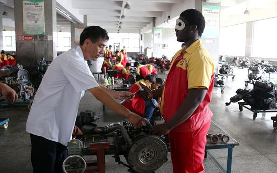 African student impresses with motor repairs and language skills