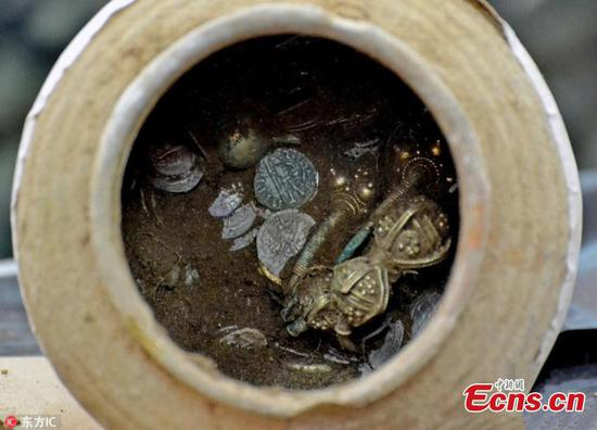 God, silver treasure pot found in Bulgaria