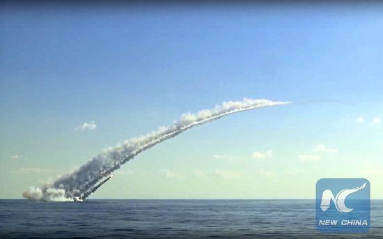 A Russian submarine in the Mediterranean fires a long-range Kalibr cruise missile at the Islamic State group's positions in Syria on Oct. 5, 2017.