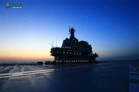 China's second aircraft carrier returns to dock at Dalian Shipyard in Northeast China's Liaoning Province, May 18, 2018, after its first sea trials.  (Photo/81.cn)