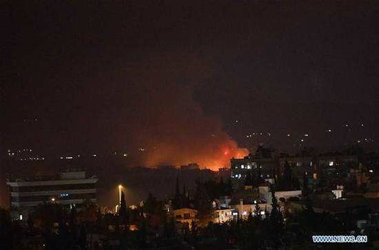 Photo taken on Sept. 2, 2018 shows the fire and smoke rising from the Mazzeh airbase in the Damascus' western Mazzeh neighborhood, Syria, on Sept. 2, 2018. The Syrian army denied reports that an Israeli missile attack targeted a Syrian airbase west of Damascus early Sunday, saying a short circuit caused an explosion in an arms depot near the airbase, according to the state TV. (Xinhua/Ammar Safarjalani)